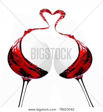 Wineglasses with red wine and heart-shaped splash, isolated on white
