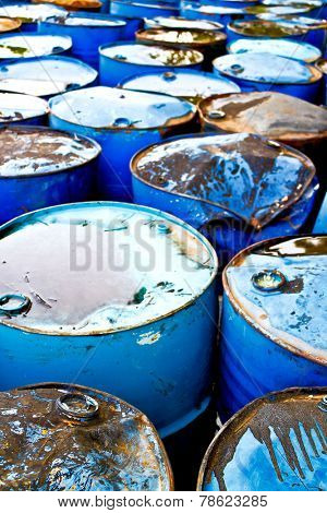 Aerial view on top of used blue oil drums