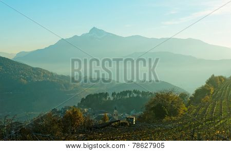 Small town in Trentino area, northern Italy, Alps in the background