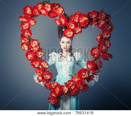 Old fashioned sexy woman with heart of flowers