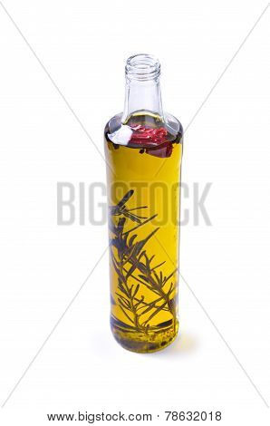 Bottle of olive oil with rosemary and pepper isolated on white background