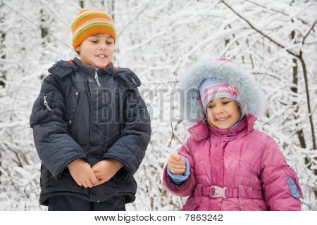 Boy And Little Girl With Bengal Fire In Hand In Winter