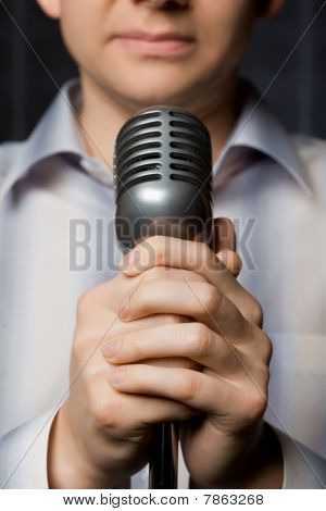 Microphone In Hands Of Man, Focus On Fingers