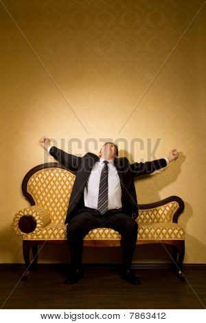 Businessman In Suit Stretches After Dream Sitting On Sofa