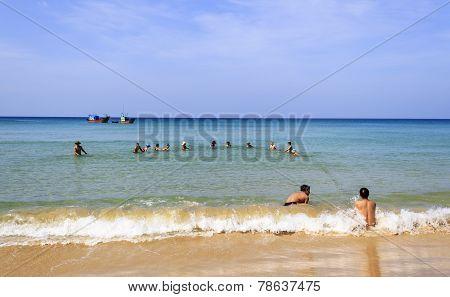 Net fishing in the beach