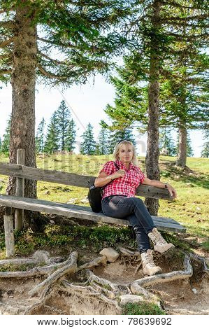 Resting Woman On A Wooden Bench