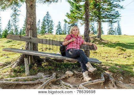 Relaxing Woman On A Wooden Bench