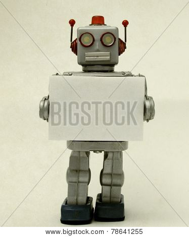 robot toy holding a sign