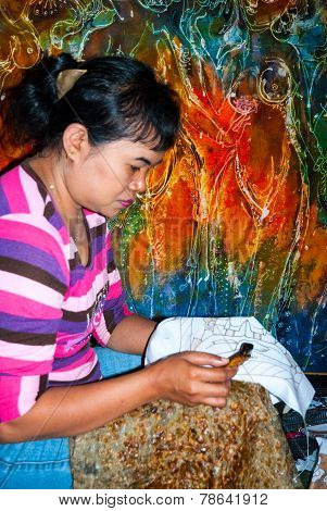 Woman Applying Wax On Batik