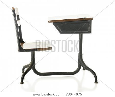 Side view of a child's antique school desk. On a white background.