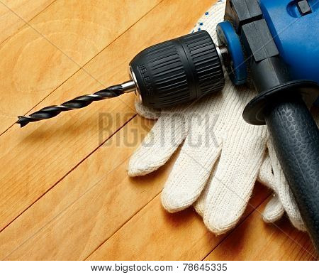 Hand Drill And Protective Gloves