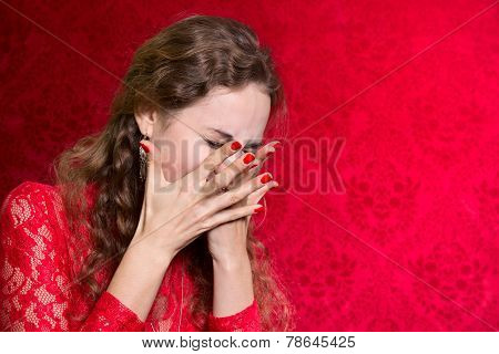 Portrait Of A Woman Covers Her Face With Her Hands