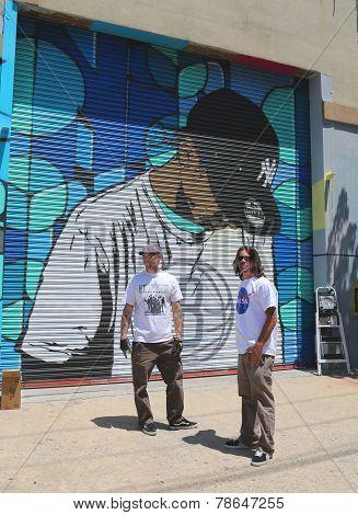 Street artists painting mural at Williamsburg in Brooklyn