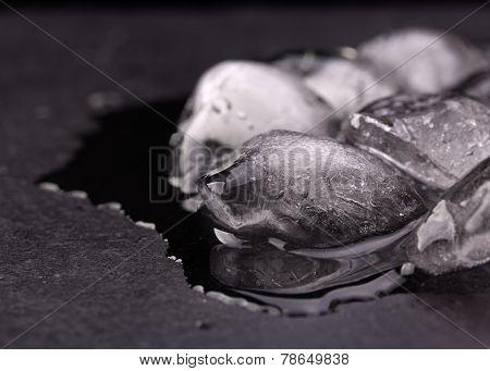 Ice Melting On Black Slate Plate
