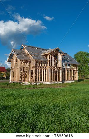 A frame house on a grass meadow