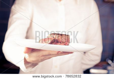 Dish Of Medallions In One Hand