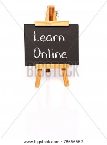 Learn Online. Blackboard with text and easel.