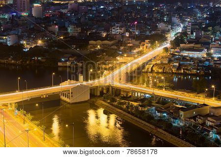 night view of Y character bridge at Ho Chi Minh Riverside with Ben Nghe or Tau Hu canal