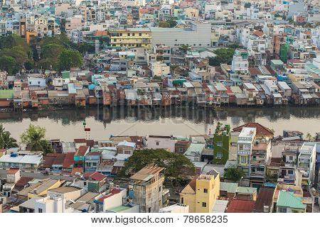 Ho Chi Minh City / Vietnam - Dec 13 2014: Poor Houses In Ho Chi Minh Riverside Cityscape View With B