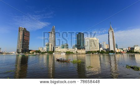 The constrast between rich and poor with skyscrapers on Saigon river at downtown of ho chi minh city