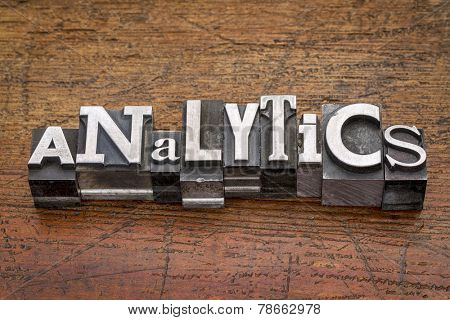 analytics word in mixed vintage metal type printing blocks over grunge wood
