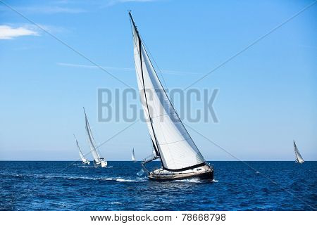 Group of sail yachts in regatta in open the Sea. Boat in sailing regatta. Luxury yachts.
