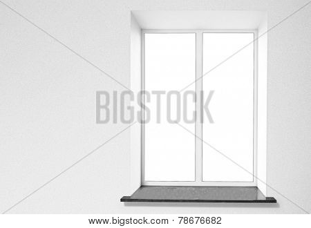 Window with windowsill and grey wall