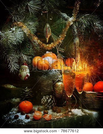 New Year's still-life with champagne, tangerines and a fur-tree