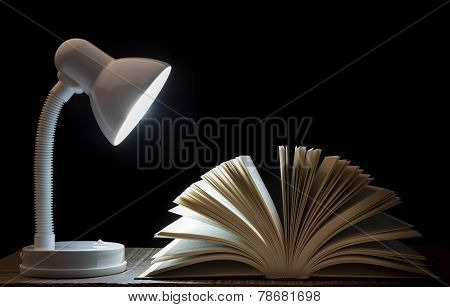 Lamp Night Light On The Book. For Reading. In Library.