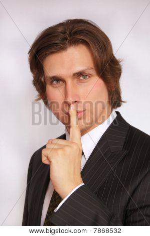 Businessman shows silence
