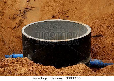 Concrete pipe in sand