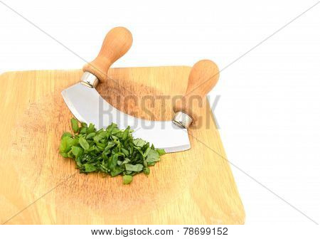 Chopped Fresh Basil Leaves With A Rocking Knife