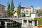 City with a bridge and river Ljubljanica poster