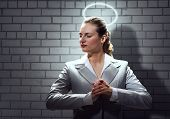 picture of halo  - Young saint businesswoman with halo above head - JPG