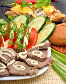 stock photo of cucumber slice  - Sliced pork tongue with mayonnaise sliced tomatoes cucumbers on white plate - JPG