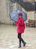 picture of dancing rain  - Young happy pretty woman standing in the rain and smiling.