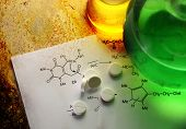 foto of reaction  - Chemistry reaction formula with white pills in closeup - JPG