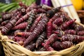 picture of food crops  - purple carrots at a food market stall  - JPG