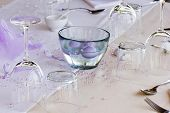 stock photo of wedding feast  - Glasses cutlery and other decorative wedding stuff on the table - JPG