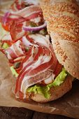 stock photo of tomato sandwich  - Submarine sandwich with bacon - JPG