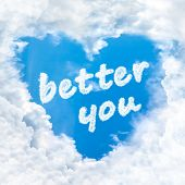 stock photo of feeling better  - better you word inside love cloud heart shape blue sky background only - JPG
