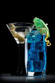 stock photo of curacao  - Blue curacao and martini cocktails on black - JPG
