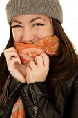 stock photo of coy  - Coy teen model wearing a beanie and scarf - JPG