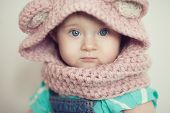 foto of baby face  - Closeup Baby Face In Hooded cowl - JPG