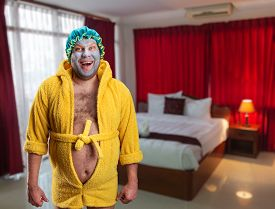 foto of madman  - Strange man with face pack in the room - JPG