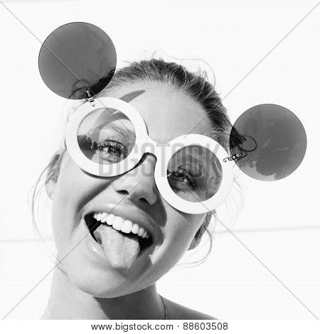 Young Girl  In Sunglasses Showing Tongue