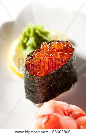 Ikura Gunkan Maki Sushi. Garnished with Ginger and Wasabi