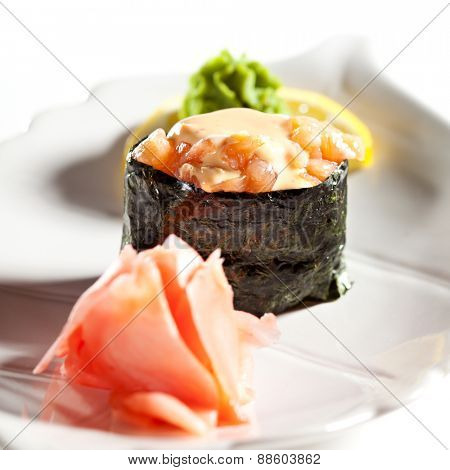 Spicy Salmon Gunkan Sushi. Garnished with Ginger and Wasabi