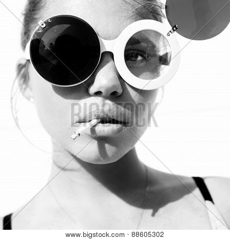 Portrait Of  Beauty Girl In Trendy Sunglasses  With Cigarette