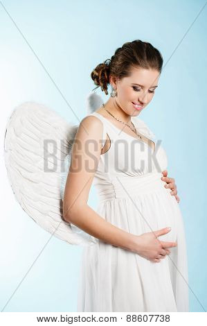 Portrait of a beautiful angelic pregnant woman. Angel